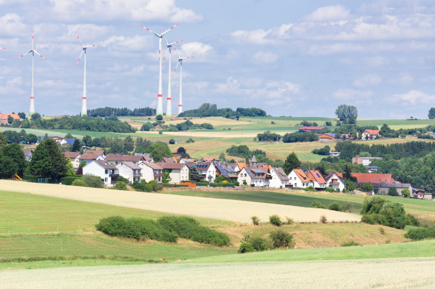 German village with houses, windmills and grain fields