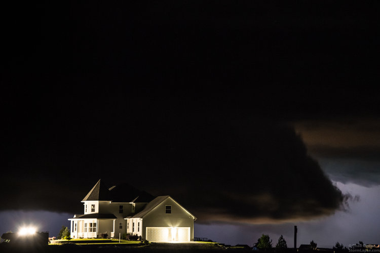 A wall cloud associated with a supercell thunderstorm approaches a house near Wilson, Kansas on May 8, 2016.