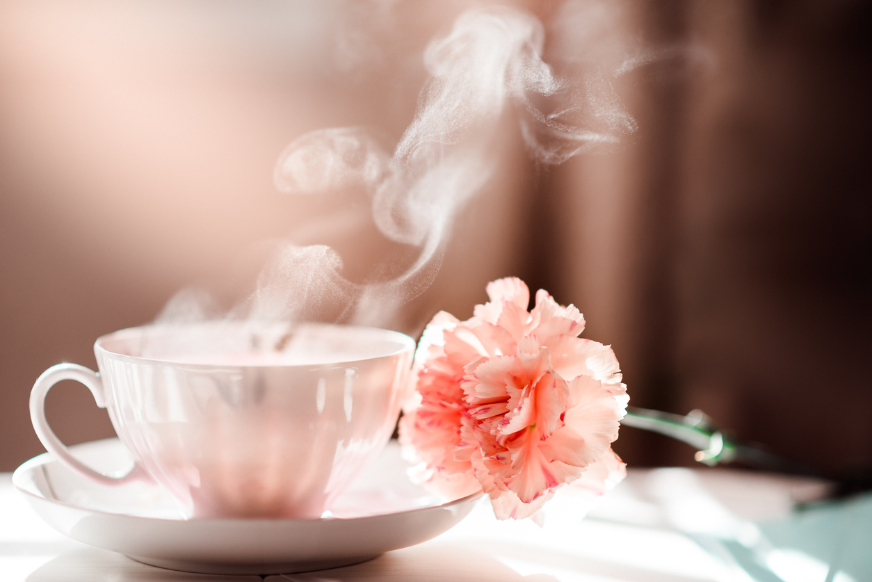 Morning Coffee Tea Cup with Steam and Carnation Flower